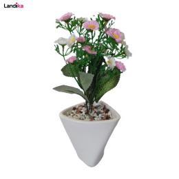 گلدان به همراه گل مصنوعی مدل شکوفه سه گوش